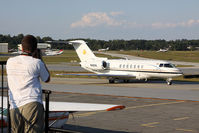Dekalb-peachtree Airport (PDK) - From the spotting location at PDK, a person photographs a nice Hawker 4000, N40VK as it taxis by for departure. - by Dean Heald