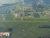 Chapman Memorial Field Airport (6CM) - Looking south across the E-W runway. - by Bob Simmermon