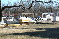 Fort Wolters Helicopters Heliport (88TS) - Unknown F-16 fuselage in a scrap yard near Mineral Wells, TX - by Zane Adams
