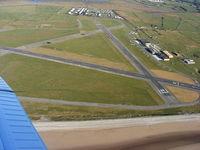 Caernarfon Airport, Caernarfon, Wales United Kingdom (EGCK) - Looking back at Caernarfon after departing from R/W 26 - by Chris Hall