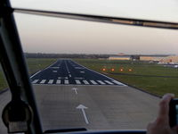 Hawarden Airport, Chester, England United Kingdom (EGNR) - about to touch down on R/W 04 at Hawarden - by Chris Hall