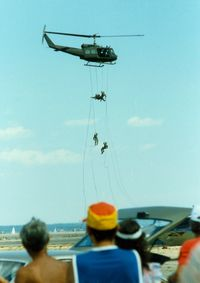 Quonset State Airport (OQU) - Rhode Island National Guard Soldiers rappelling from a Bell UH-1 Iroquois Helicopter at Quonset State Airport, North Kingstown, RI - circa 1980's - by scotch-canadian