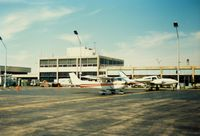 Igor I Sikorsky Memorial Airport (BDR) - Aircraft and Terminal Building at Bridgeport Municipal Airport, Bridgeport, CT - circa 1980's - by scotch-canadian