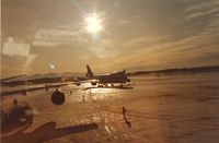 Ted Stevens Anchorage International Airport (ANC) - Sunset at Anchorage Int'l Airport, winter Feb '85 - by Henk Geerlings