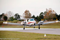 Orlando Apopka Airport (X04) - Duchess lifting off of runway 15. - by ApopkaHangars.com