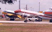 Opa-locka Executive Airport (OPF) - Yellow plane is N50E , cn 11657  DC-3A