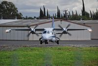El Monte Airport (EMT) - Mitsubishi MU-2 Holding Short for departure El Monte - by Rich Spellman
