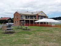 Tyabb Airport - Peninsula Aero Club building from another angle, showing barbeque area and preparations for the airshow on Sunday, March 4. - by red750