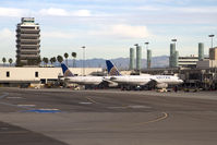 Los Angeles International Airport (LAX) - A pair of United Airlines aircraft parked at Terminal 8. The control tower on the left was in use from October 1962 to April 1996. - by Dean Heald