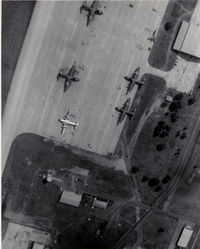 Khorat Air Force Base - Overhead pattern summer 1972.  Note the F-105 that is in two pieces in the upper right corner. - by Ronald Barker