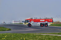 Liverpool John Lennon Airport - Liverpool Fire Service tender 1 on taxiway with light aircraft and airport terminal building in background.   - by Mark J Kopczewski