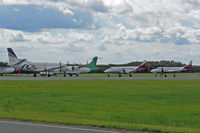 Brisbane International Airport, Brisbane, Queensland Australia (YBBN) - Busy ramp for small cargo props - by Micha Lueck