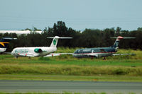 Brisbane International Airport, Brisbane, Queensland Australia (YBBN) - A couple of unexpected tails in Australia: F100s of Germania (Germany) and US Airways (USA) - used for parts by Alliance - by Micha Lueck