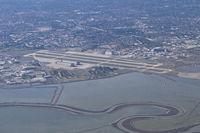 Moffett Federal Afld Airport (NUQ) - Moffett Federal Airfield, as seen on RWY 28R approach to KSFO. - by Mark Kalfas