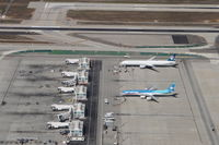 Los Angeles International Airport (LAX) - Air Tahiti Nui A343 and Air New Zealand B773 at West/Remote Gates. - by Mark Kalfas