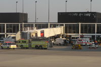 Chicago O'hare International Airport (ORD) - Chicago, Illinois - Chicago Fire Department - O'Hare Airport Rescue 2, Engine 10 and Ambulance 16   responding to a call at the Delta Airlines Terminal 2, Gate E10. - by Mark Kalfas