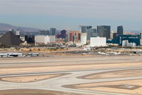 Mc Carran International Airport (LAS) - Las Vegas, McCarran International looking at the west/northwest side of the airport with the Strip in the background as seen on departure from RWY 25R. - by Mark Kalfas