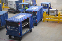 Dallas/fort Worth International Airport (DFW) - Baggage carts - by Ronald Barker