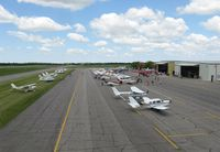 Chandler Field Airport (AXN) - View of the ramp during the latter hours of the 2012 fly-in lunch. - by Kreg Anderson