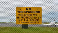 Buffalo Niagara International Airport (BUF) - A sign reading No Trespassing violators will be prosecuted by N.F.T.A Police. Section 1151-4 - by aeroplanepics0112
