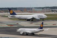 Frankfurt International Airport, Frankfurt am Main Germany (EDDF) - Some feet and 19 years on duty are between those two at rwy 25C.... - by Holger Zengler