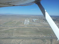 Roswell International Air Center Airport (ROW) - From a point 2 miles SE of the Roswell International Air Air Center Airport at approximately 1,000' AGL looking northwest, about 125 aircraft are visible on the tarmac. - by Richard Warner