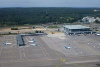 Luxembourg International Airport - Luxembourg Findel on a beautiful summer afternoon. 6 out of Luxair's 18 airplanes at homeport. Luxair operates 5 B737 Next Gen, 7 DHC Dash 8 & 6 Embraer 145. - by Jean M Braun