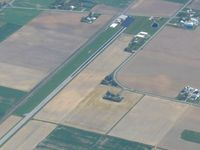Ruhe's Airport (R47) - Looking NE w/crop dusters on the ramp. - by Bob Simmermon