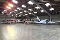 Turweston Aerodrome Airport, Turweston, England United Kingdom (EGBT) - inside the main hangar at Turweston - by Chris Hall