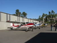 Santa Paula Airport (SZP) - Five Cessna 180s and a Cessna A185 on display at the Aviation Museum of Santa Paula taxiway. Aircraft displays change every First Sunday Fly-In and Open Museum Hangars crawl - by Doug Robertson