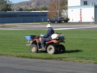 Santa Paula Airport (SZP) - Slow commercial spraying with extended hand nozzle-Rwy 22L grass. Breathing mask, gloves worn. - by Doug Robertson