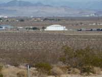 Inyokern Airport (IYK) - The large white building in the center of the picture is the Kodiak hanger at Inyokern. Supposedly named after a type of hanger first built in Alaska, this hanger was built by the U.S. Navy in 1943 when Inyokern was used for ordinance testing. - by Bo Shaw