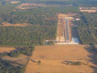 Oak Tree Landing Airport (6J8) - Looking down RWY 9 - by Bob Simmermon