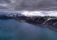 Pangnirtung Airport - looking north and the airport just off to the north east. - by Tim Kalushka