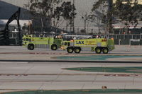 Los Angeles International Airport (LAX) - LAX ARFF 80 and ARFF 280 escorting an aircraft to the American Maintenance Hangar. 