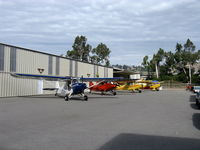 Santa Paula Airport (SZP) - First Sunday Aviation Museum of Santa Paula with four 1946 Aeronca 7AC CHAMPIONs on the ramp. Early photo-one more 7AC arrived plus a 1946 11AC Chief parked on the nearby transient ramp. - by Doug Robertson