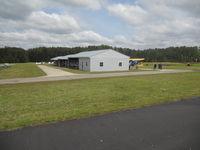 W.n.c. Air Museum Airport (8NC9) - One row of hangers - by Kamyar Kheradpir