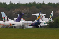 Lasham Airfield Airport, Basingstoke, England United Kingdom (EGHL) - storage area at Lasham, three former BMI Baby B737's at the rear and from L to R are N217FE Boeing 727 2S2F, VP-BVU Boeing 737-5Q8, N279CSBoeing 737-33V and M-FAHDBoeing 727-76 - by Chris Hall
