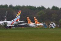 Lasham Airfield Airport, Basingstoke, England United Kingdom (EGHL) - In storage at Lasham, from L to R N280CS Boeing 737-33V, G-CHOB Boeing 737-883, N615SC Boeing 737-5Y0 and N616SC Boeing 737-5Y0 - by Chris Hall