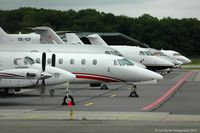 Geneva Cointrin International Airport - A line up of aircraft on the RUAG ramp - by Carl Byrne (Mervbhx)