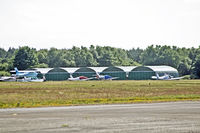 Blackbushe Airport - New hangarage in place in aircraft park - by OldOlympic