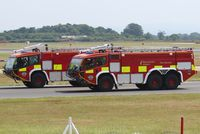 Manchester Airport, Manchester, England United Kingdom (EGCC) - Two of Manchester Airport's fire engines.  - by Graham Reeve