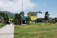 F.D. Roosevelt Airport – Sint Eustatius, Netherlands Antilles,  Netherlands Antilles (TNCE) - The airport buliding seen from the runway. - by Tomas Milosch