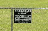 Yellow River Airstrip Airport (FD93) - SIGN ON FENCE AT AIRPORT - by dennisheal
