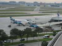 Tampa International Airport (TPA) - AirTran aircraft at remote terminal B at Tampa Int'l Airport - by Ron Coates