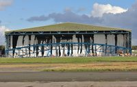 Bournemouth Airport, Bournemouth, England United Kingdom (EGHH) - Building screen for hangar extension shredded in violent storm - by John Coates