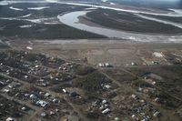 Fort Yukon Airport (FYU) - Fort Yukon, Alaska during breakup of the Yukon River prior to minor flooding of runway.  Taken from Wright Air N4637U piloted by Dave Lorring. - by David Lee