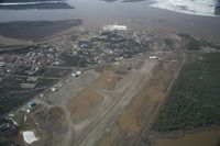 Fort Yukon Airport (FYU) - Fort Yukon, Alaska.  Minor flooding of ramp during breakup of Yukon River.  Taken from Wright Air N4637U piloted by Dave Lorring. - by David Lee