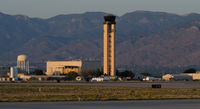 Albuquerque International Sunport Airport (ABQ) - The control tower at evening.  The tower controls both domestic and military operations as this airport is jointly used by Kirtland Air Force Base. - by Roland Penttila