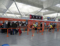 London Stansted Airport - Check in for EasyJet - by Henk Geerlings
